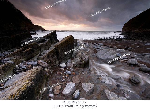 England, Devon, Lee Bay. A stormy dusk at Lee Bay on the North Devon coast