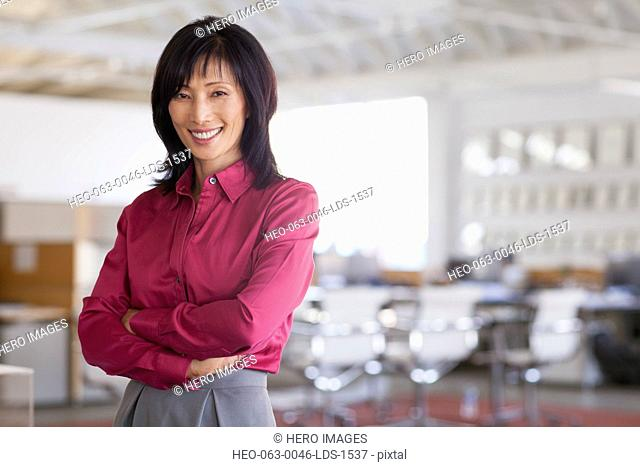 portrait of pretty middle aged asian businesswoman