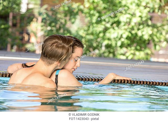 Passionate couple in swimming pool