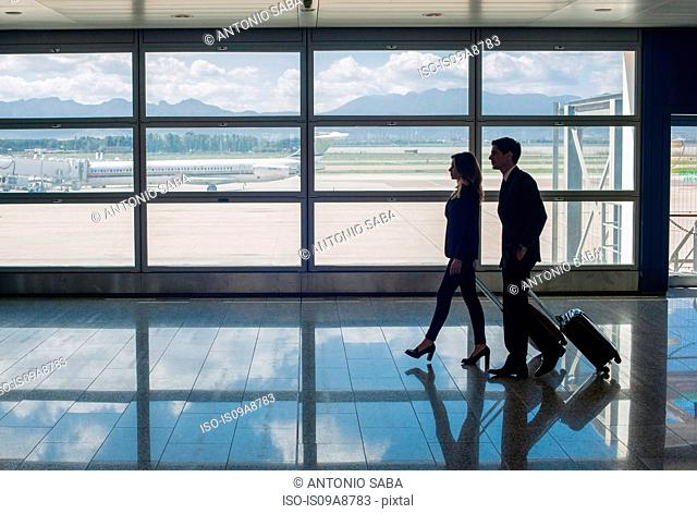 Businesspeople walking in airport