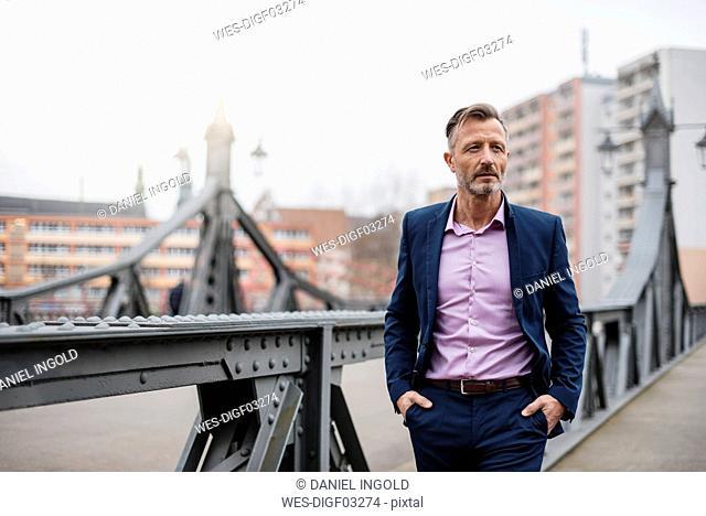 Portrait of stylish mature businessman wearing blue suit