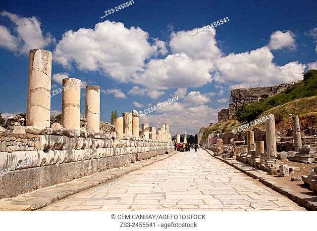 Tourists at the ancient road leading to the Great Theatre at the Roman ruins of Ephesus, Efes, Selcuk, Kusadasi,Turkey, Europe