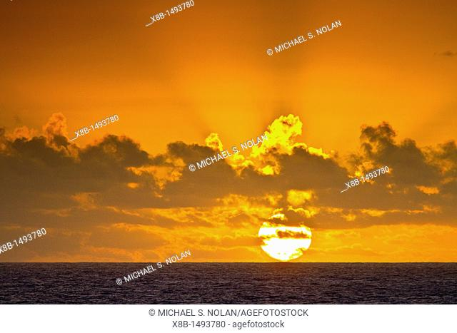 Sunset at sea near Nightingale Island, part of the Tristan da Cunha Group, South Atlantic Ocean  MORE INFO The Tristan da Cunha Island Group is administered by...