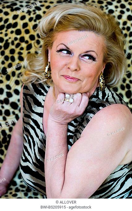 portrait of an older blond woman with tigerpattern top