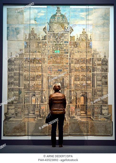 A woman stands in front of the woodcut 'Arch of Maximilian I' by Albrecht Duerer at the Staedel Museum in Frankfurt Main, Germany, 22 October 2013