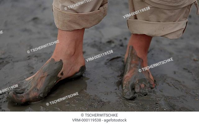 Feet in the mud, dead sea, Israel