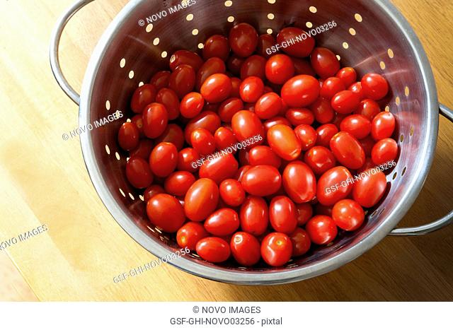 Cherry Tomatoes in Colander, High Angle View