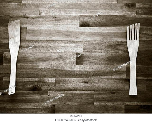 Wooden fork and spatula on the table - tinted black and white image