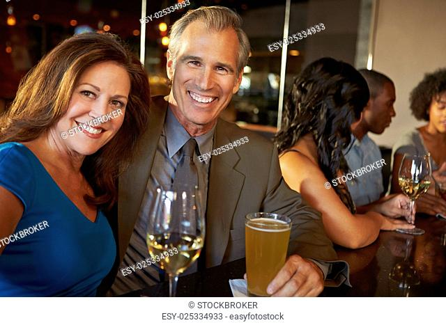 Mature Couple Enjoying Drink In Bar Together