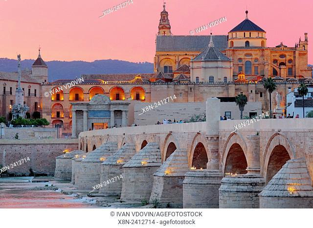 Cathedral (Mezquita) and Roman bridge at sunset, Guadalquivir river, Cordoba, Andalusia, Spain