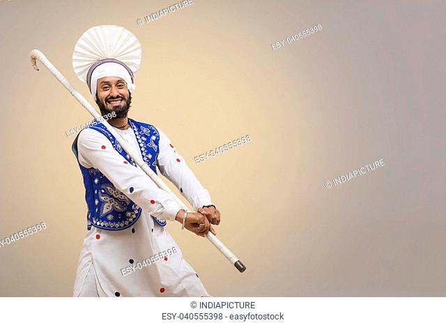 Portrait Of Sikh Man Doing Bhangra Dance