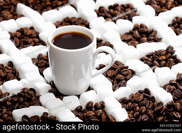 cup of coffee with coffee beans and sugar