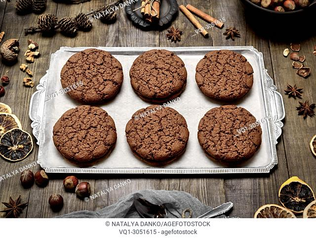 baked round chocolate chip cookies on a silver plate, top view