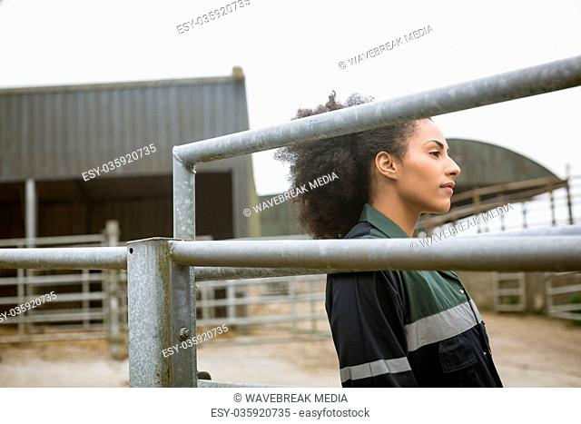 Woman leaning on standing near barn
