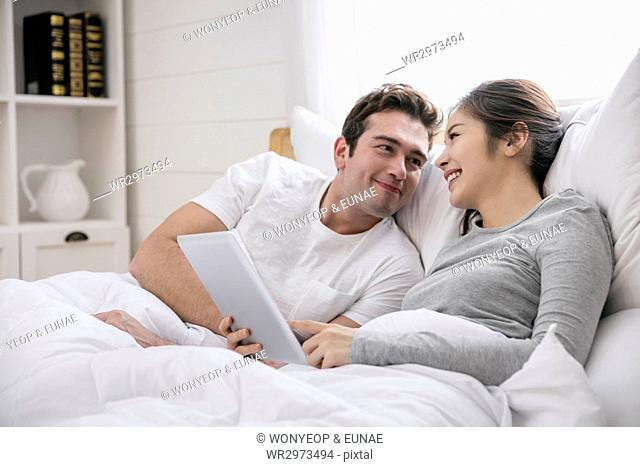 Lifestyle of harmonious multicultural family couple