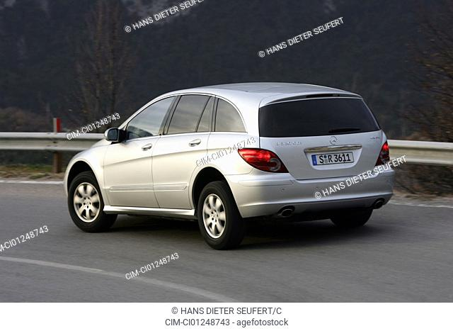 Mercedes R 320 CDI 4matic, model year 2005-, silver, Mountains, driving, diagonal from the back, rear view, country road