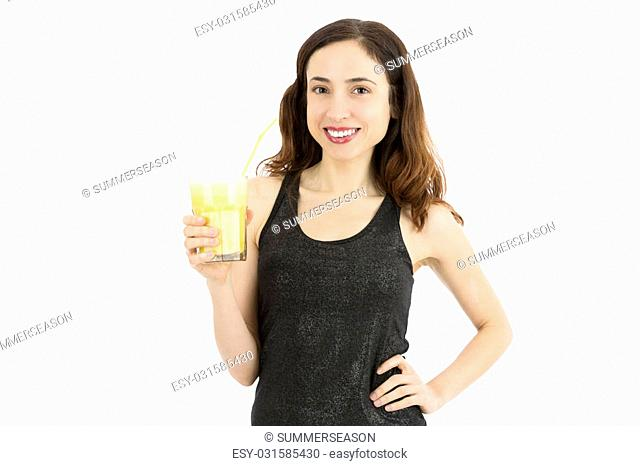 Young woman drinking a glass of banana smoothie