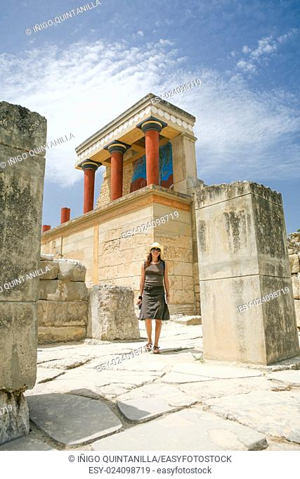 woman traveler tourist walking in landmark monument minoan Knossos palace ruins, from 2000 year Before Christ, one of the most important greek monuments in...