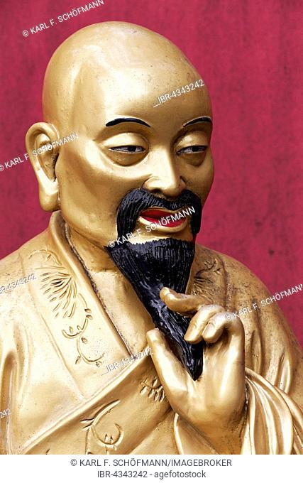 Arhat, Buddhist Sage, stroking his goatee thoughtfully, gilded figure, Temple of 10,000 Buddhas, Sha Tin, New Territories, Hong Kong, China