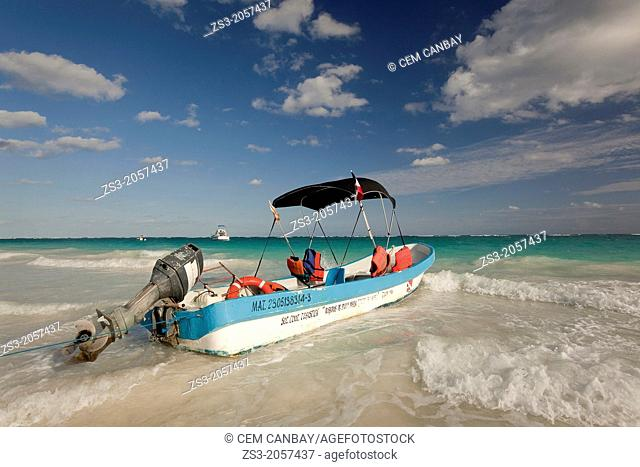 Fishing Boat moving at Tulum beach on a windy day, Tulum, Quintana Roo, Mexico