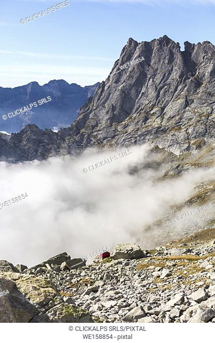 The Cavalcorto peak at Molteni biwak in Ferro valley clods above