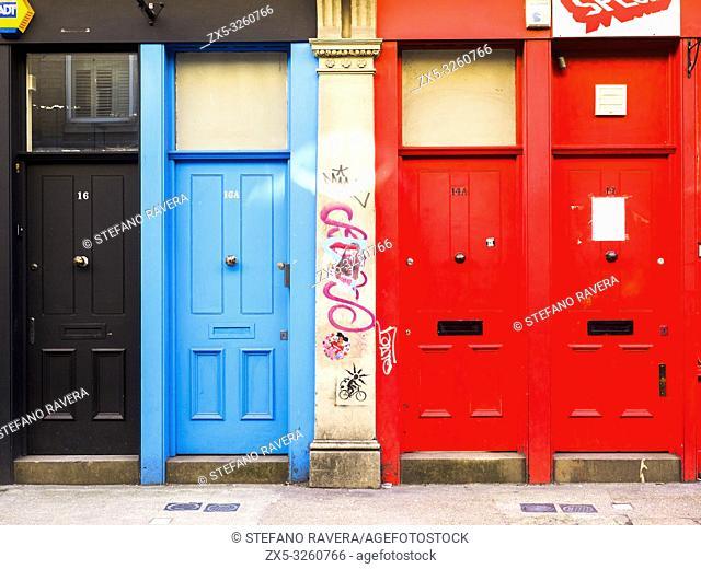Colourful doors in Cheshire street near Brick lane - London, England