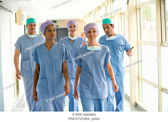 Medical team walking in the corridor of a hospital