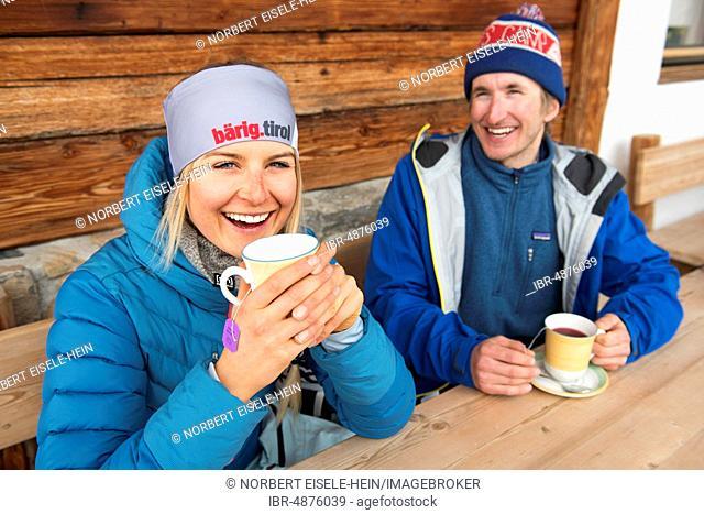 Skiers during the tea break, coffee break at the hut, Hohe Salve, Hopfgarten, Tyrol, Austria