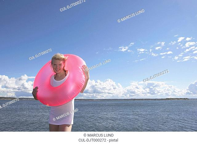 Young woman with swimming ring