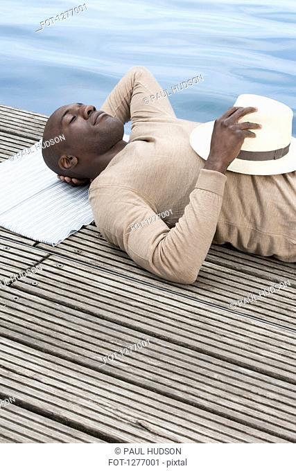 Man relaxing on decking