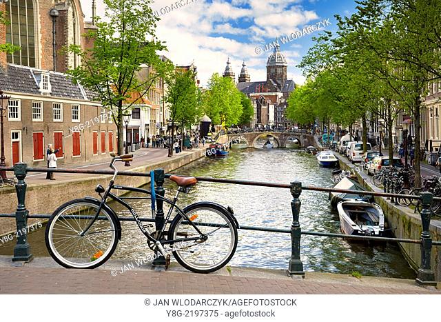 View at bicycle, canal and St.Nicolas Church - Amsterdam, Holland Netherlands