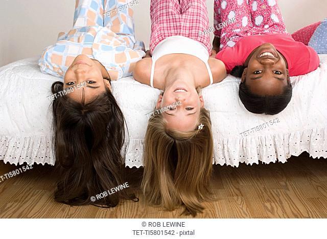 Three girls 10-11 having fun at slumber party