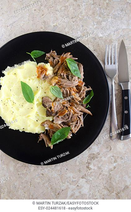 Pulled pork with mashed potatoes and hot sauce