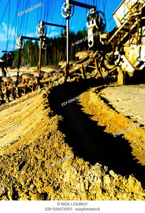 Vertical vivid sand mining machine bokeh background backdrop