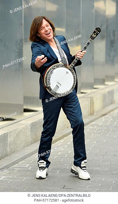 EXCLUSIVE - German singer Juergen Drews pose in Berlin, Germany, 24 March 2015. He holds a banjo which was given to him by actor and musician E