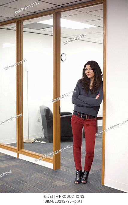 Caucasian businesswoman standing in office