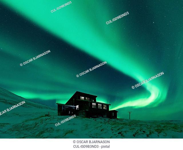 House under aurora borealis at night, Thingvellir, Iceland