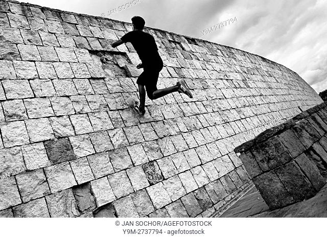 A Colombian parkour runner jumps on the wall during a free running training session of Tamashikaze team in a park in Kennedy, Bogotá, Colombia, 21 February 2016