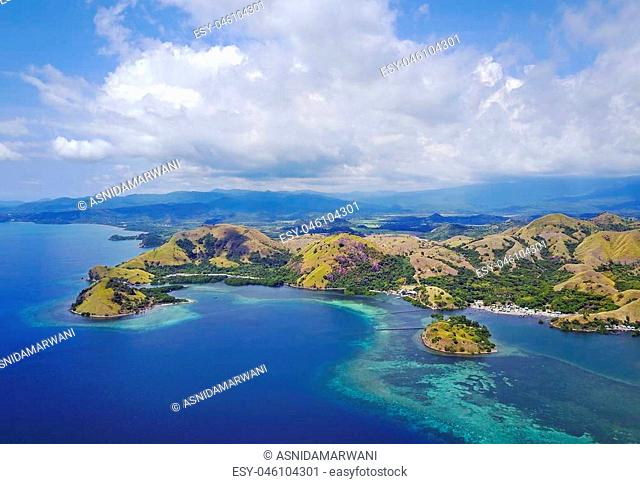 Beautiful aerial view of beaches and tourist boat sailing in Flores Island, Indonesia