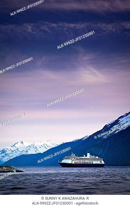 Holland America cruiseship Volendam leaving port of Skagway at twilight, Skagway, Southeast Alaska