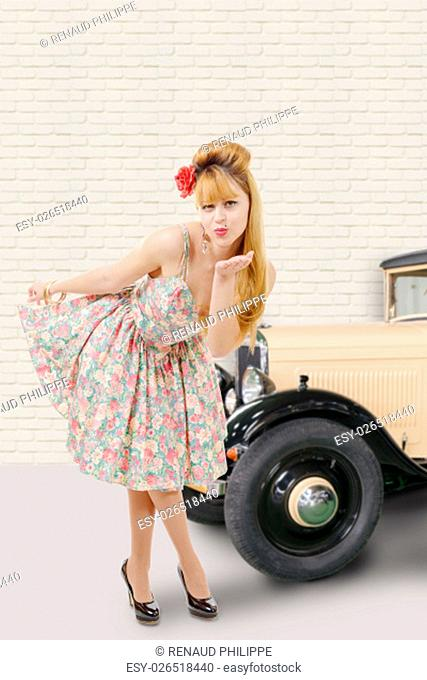 pretty pinup girl sending kisses, vintage car background