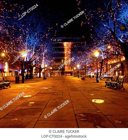 England, London, Sloane Square, Lights on trees at Sloane Square. The square is named after Sir Hans Sloane 1660-1753 who was an Ulster-Scot and physician