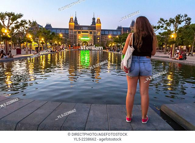 amsterdam, Holland, The Netherlands, Outside, the Rijksmuseum Museum, Female Tourist Taking Photos Lighting at Night, with Pond