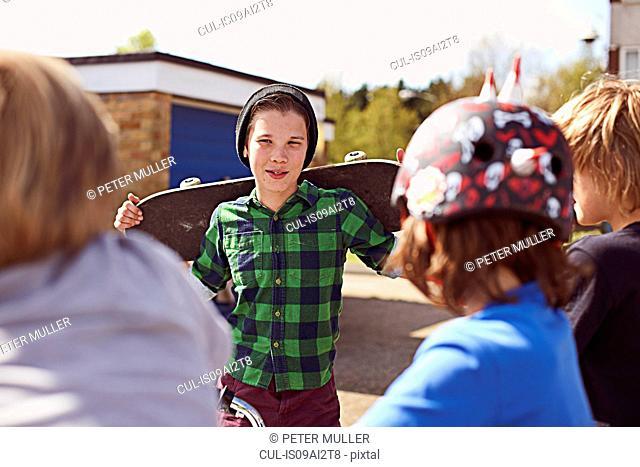 Boy holding skateboard