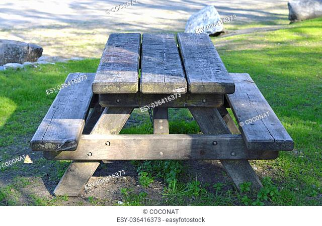 Wooden picnic table in the park walking holidays