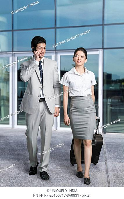 Business couple at an airport lounge