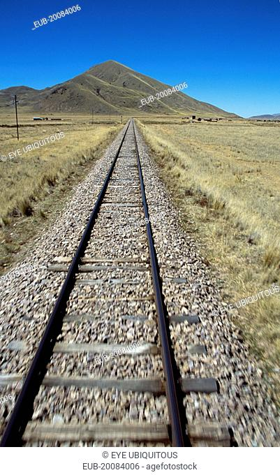 Railway track through the Andes mountain range, Puno to Cusco Perurail train journey