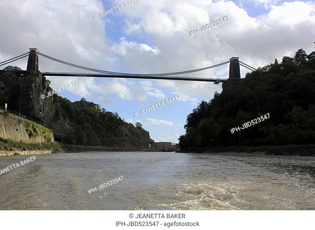 England Bristol BBrunel's Clifton Suspension Bridge late on an Autumn afternoon from apleasure boat on the River Avon