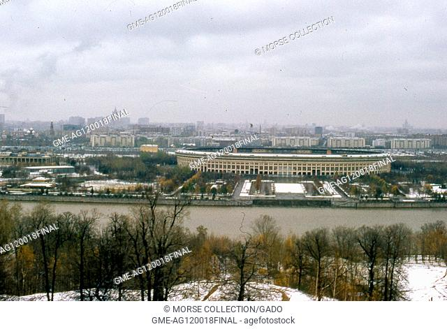 Panoramic view facing northeast of Luzhniki Olympic Stadium, seen from Sparrow Hills Park across the Moskva River, in Moscow, Soviet Russia, USSR, November