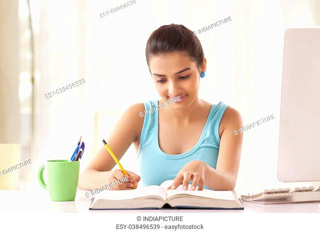 Portrait of Teenage Girls student studying at the table